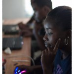 Nigeria, a student concentrates on the work at hand
