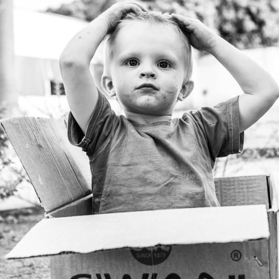 Micah in a box in Nigeria