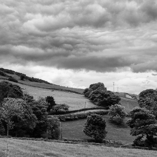 The Rolling Hills and Looming Clouds