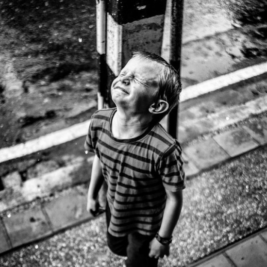 My son, Micah enjoying the rain...