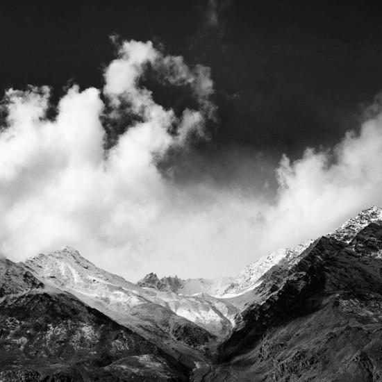 Clouds billow over the Himalayas
