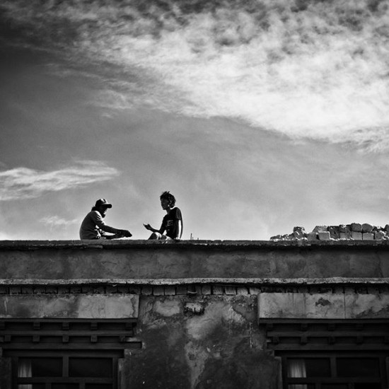 Sitting on the roof having a chat, India