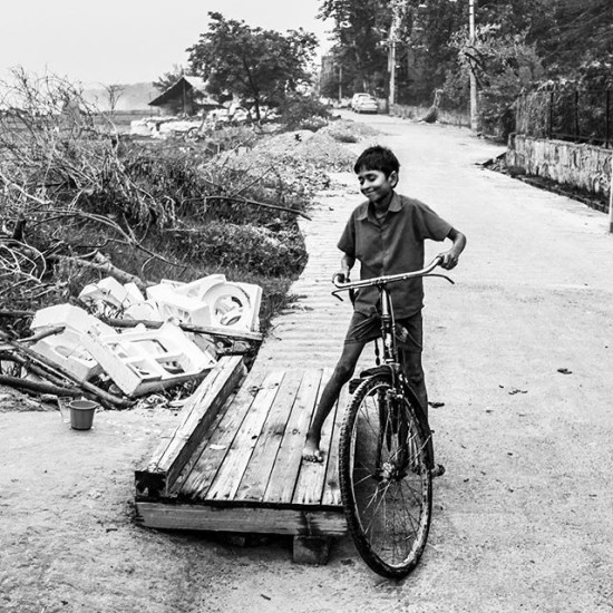 Ready to Ride... ; ) I met this kid in New Delhi. He was so proud of himself... I love his expression too. Pure delight. It's important that all of us feel that as much as we can about our lives! ; )
