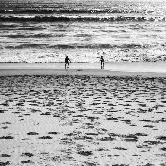 My kids running into the ocean in South Africa