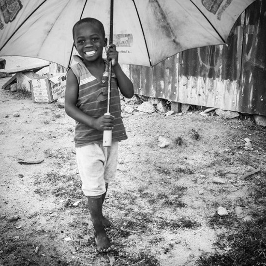 Just a boy and his umbrella, Nigeria